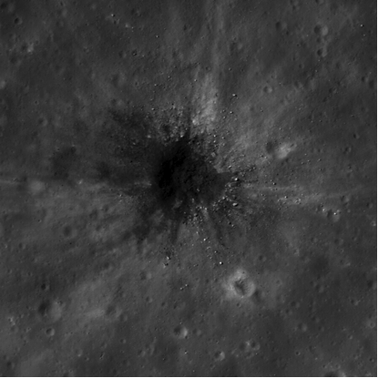 Impact revealing buried lava flows: This LROC NAC image (taken from M112183669LE) is a good example of a dark haloed impact crater that has punched through a light surface deposit and has excavated darker material from an underlying lava flow. Image: LROC/NASA.